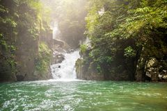 Mountain waterfall in Sunny day. royalty free stock images