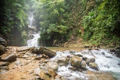 Mountain waterfall in Sunny day stock photo