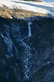 Mountain waterfall on the way to Mendelhall glacier 2. Mendenhall Glacier is a glacier about 13.6 miles long located in Mendenhall Valley, about 12 miles from Stock Photo