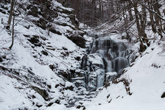 Mountain waterfall at winter. Carpathian mountains, Ukraine. The Mountain waterfall at winter. Carpathian mountains, Ukraine Stock Photos