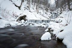 Mountain waterfall at winter. Carpathian mountains, Ukraine. The Mountain waterfall at winter. Carpathian mountains, Ukraine Royalty Free Stock Images