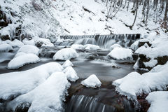 Mountain waterfall at winter. Carpathian mountains, Ukraine Royalty Free Stock Images