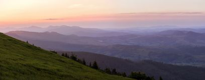 Mountain waves. Sunset in the mountains in Carpathians Stock Photos