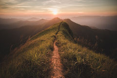 Mountain. The way of climax. Mountain slope have a way for walk. Background is sunset royalty free stock image