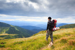 Mountain wayfarer with dog Royalty Free Stock Photo