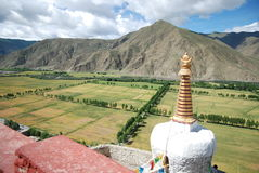 Mountain, wheat, white tower. This is the story of the first piece of farmland in Tibet Royalty Free Stock Photography