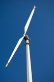 Mountain wind turbine. An high mountain wind turbine with blue sky background Stock Photos
