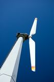 Mountain wind turbine. An high mountain wind turbine with blue sky background Stock Images
