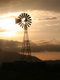 Mountain Windmill. Windmill in the country with mountains and a sunset Royalty Free Stock Photos