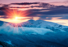 Mountain winter landscape. Fantastic evening glowing by sunlight. Royalty Free Stock Photos