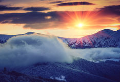 Mountain winter landscape. Fantastic evening glowing by sunlight. Stock Photos