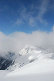 Mountain winter slope in clouds Royalty Free Stock Photo