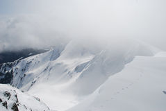 Mountain winter slope in clouds Stock Photography