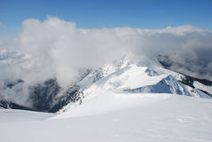 Mountain Winter Slope In Clouds. Stock Photography