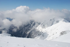Mountain Winter Slope In Clouds. Royalty Free Stock Photos