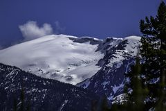 Mountain In The Winter With a Snow Cornice. A view of a mountain on a winter clear day with a snow cornice stock photo