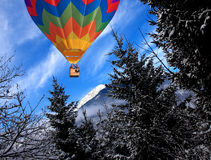 Mountain in winter time and balloon Stock Photo