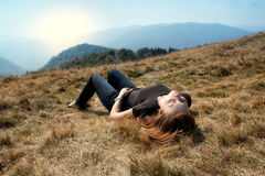 Mountain Woman. Laying in the grass Stock Image