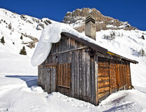 Mountain wooden cabin log in the Dolomites, Passo Fedaia Royalty Free Stock Photography