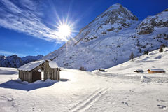 Mountain wooden cabin logs in the Dolomites, Passo Fedaia Royalty Free Stock Photos
