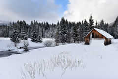 Mountain wooden chalet covered with fresh snow Stock Photos