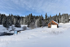 Mountain wooden chalet covered with fresh snow Royalty Free Stock Photography