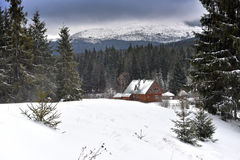 Mountain wooden chalet covered with fresh snow Royalty Free Stock Images