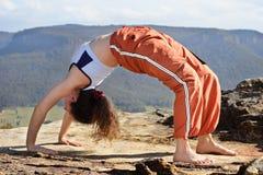 Mountain yoga 3. Difficult bridge pose royalty free stock photo