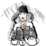 Mountain - Young woman having breakfast before skiing Stock Photography