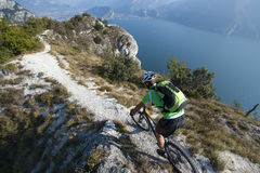 Mountainbike adventure  - garda lake. Biking over the garda lake - downhill Royalty Free Stock Photos