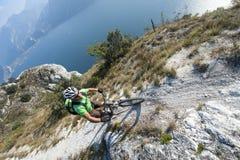 Mountainbike adventure  - garda lake. Mountainbiker above the garda lake Stock Photography