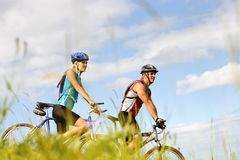 Mountainbike couple outdoors Royalty Free Stock Photography