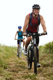 Mountainbike couple outdoors Stock Photo