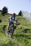 Mountainbike dowhnill. Mountainbiking in the mountains - downhill trail Royalty Free Stock Photography