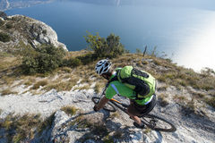 Mountainbike downhill adventure - garda lake. Biking above the garda lake Royalty Free Stock Photography