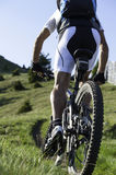 Mountainbike uphill. The first Mountainbiker in the race Stock Photo