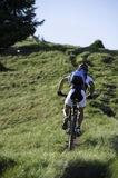 Mountainbike uphill. The race leader from behind Royalty Free Stock Photos