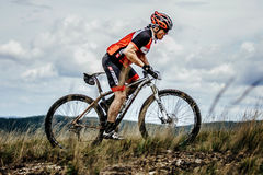 Mountainbiker cyclist rides on trail top of mountain Royalty Free Stock Photography