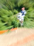 Mountainbiker jumping Stock Image