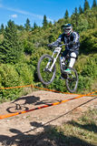 Mountainbiker jumping - in motion blurr Stock Images