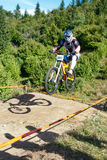 Mountainbiker jumping - in motion blurr Royalty Free Stock Images