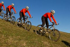 Mountainbiker on a meadow. Series of a mountainbiker on a meadow Royalty Free Stock Image