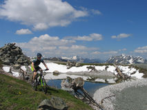 Mountainbiker riding through the Alps Stock Image