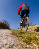 Mountainbiker on a street Royalty Free Stock Photos