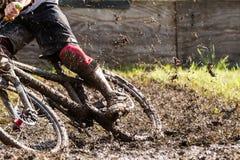 Mountainbiker wit a lot of mud Stock Image