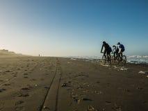 Mountainbikers on the beach Royalty Free Stock Photos