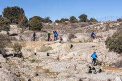 Mountainbikers in Guadarrama Mountains. Colmenar Viejo, Madrid, Spain, on February 8, 2015 Royalty Free Stock Photos