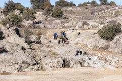 Mountainbikers in Guadarrama Mountains. Colmenar Viejo, Madrid, Spain, on February 8, 2015 Royalty Free Stock Image