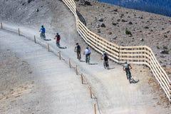 Mountainbikers. People on mountain bikes riding on a mountain ridge Royalty Free Stock Photo