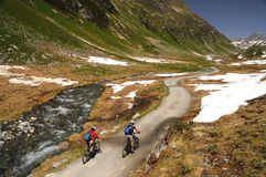 Mountainbikers riding in the Alps. Mountainbikers riding on a beautiful trail, over 2000m in the Alps Royalty Free Stock Photo